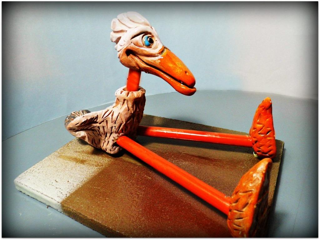 Pájaro de cerámica y metal